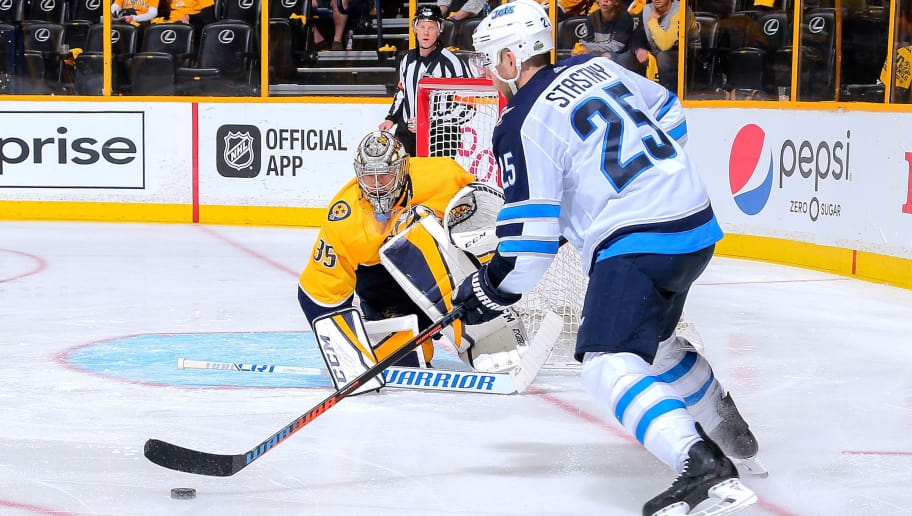 NASHVILLE, TN - APRIL 27:  Paul Stastny #25 of the Winnipeg Jets lines up to take a shot against goalie Pekka Rinne #35 of the Nashville Predators during the second period in Game One of the Western Conference Second Round during the 2018 NHL Stanley Cup Playoffs at Bridgestone Arena on April 27, 2018 in Nashville, Tennessee.  (Photo by Frederick Breedon/Getty Images)