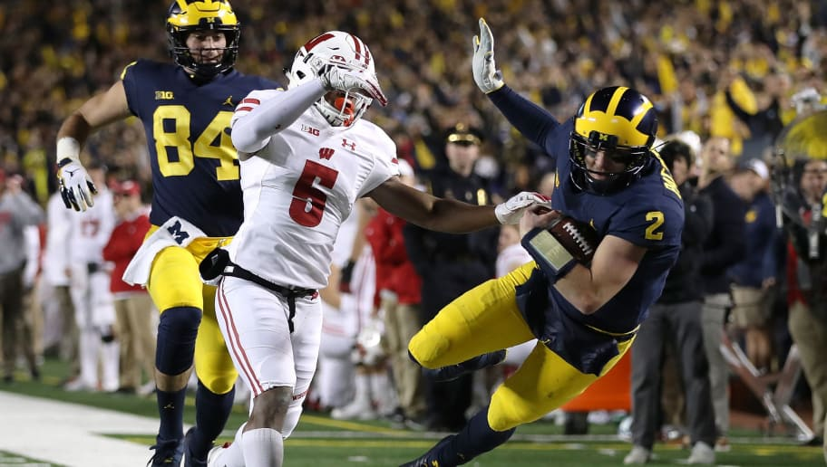 ANN ARBOR, MI - OCTOBER 13: Shea Patterson #2 of the Michigan Wolverines is knocked out of bounds after a long first half run by Rachad Wildgoose #5 of the Wisconsin Badgers on October 13, 2018 at Michigan Stadium in Ann Arbor, Michigan. (Photo by Gregory Shamus/Getty Images)