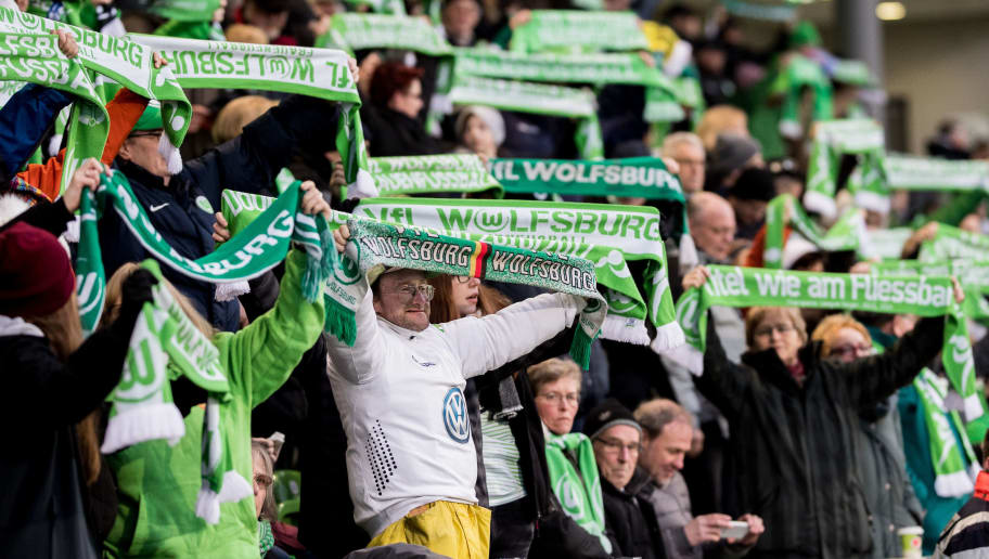 WOLFSBURG, GERMANY - MARCH 22:  Fans of Wolfsburg celebrate prior to the UEFA Women's Champions League Quarter Final first leg match between VfL Wolfsburg and Slavia Praha at AOK-Stadion on March 22, 2018 in Wolfsburg, Germany. (Photo by Boris Streubel/Getty Images)