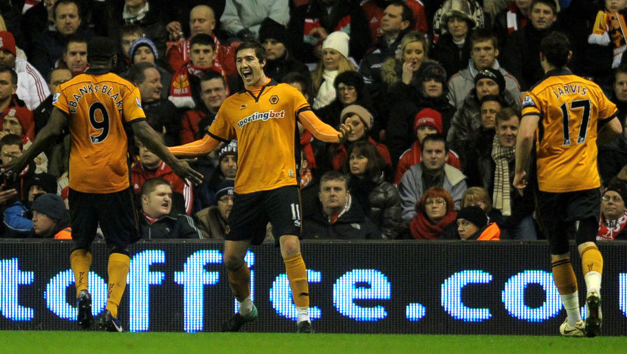 Wolverhampton Wanderers' Irish defender Stephen Ward (C) celebrates after scoring during their English Premier League football match against Liverpool at Anfield, Liverpool, northwest England, on December 29, 2010. AFP PHOTO/ ANDREW YATES --- RESTRICTED TO EDITORIAL USE Additional licence required for any commercial/promotional use or use on TV or internet (except identical online version of newspaper) of Premier League/Football League photos. Tel DataCo +44 207 2981656. Do not alter/modify photo (Photo credit should read ANDREW YATES/AFP/Getty Images)