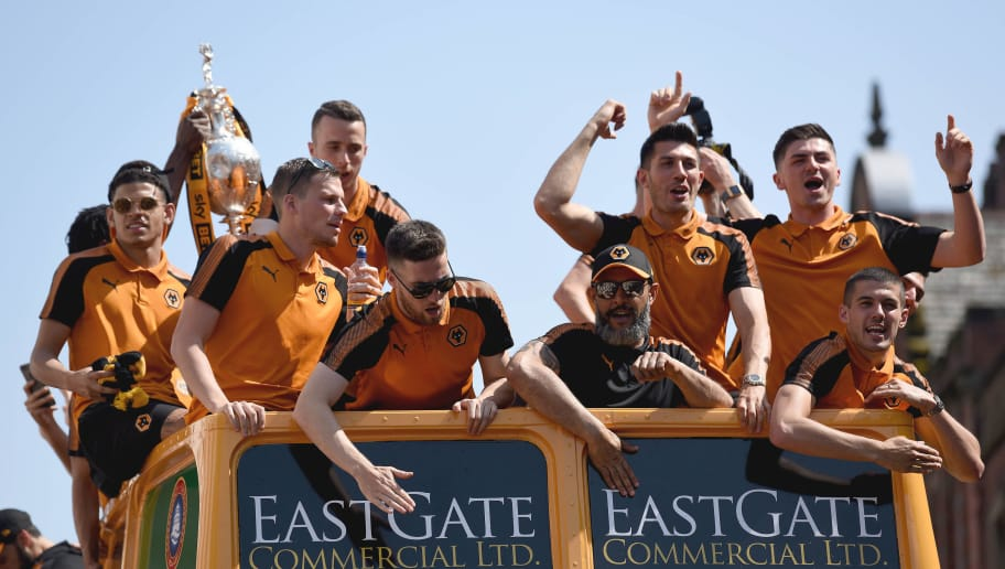 WOLVERHAMPTON, ENGLAND - MAY 07: Wolverhampton Wanderers on an open topped bus during their celebrations of winning the Sky Bet Championship on a winners parade around the city of Wolverhampton on May 7, 2018 in Wolverhampton, England. (Photo by Sam Bagnall - AMA/Getty Images)