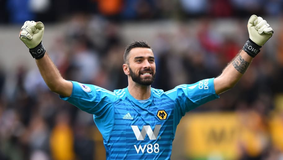 WOLVERHAMPTON, ENGLAND - SEPTEMBER 16:  Rui Patricio of Wolverhampton Wanderers celebrates after teammate Raul Jimenez scores their teams first goal during the Premier League match between Wolverhampton Wanderers and Burnley FC at Molineux on September 16, 2018 in Wolverhampton, United Kingdom.  (Photo by Nathan Stirk/Getty Images)