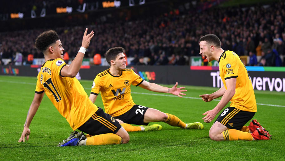 WOLVERHAMPTON, ENGLAND - DECEMBER 05:  Diogo Jota of Wolverhampton Wanderers celebrates with teammates after scoring his team's second goal during the Premier League match between Wolverhampton Wanderers and Chelsea FC at Molineux on December 5, 2018 in Wolverhampton, United Kingdom.  (Photo by Laurence Griffiths/Getty Images)