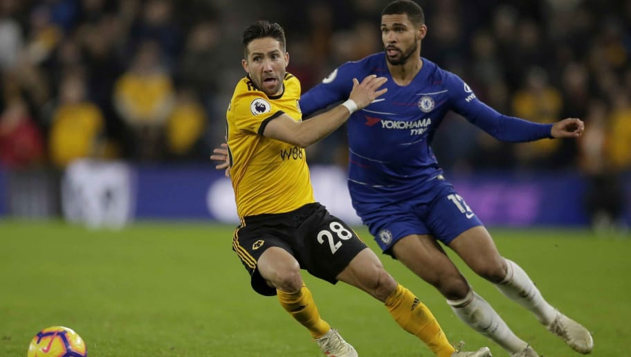 WOLVERHAMPTON, ENGLAND - DECEMBER 05: Joao Moutinho of Wolverhampton Wanderers competes with Ruben Loftus-Cheek of Chelsea during the Premier League match between Wolverhampton Wanderers and Chelsea FC at Molineux on December 05, 2018 in Wolverhampton, United Kingdom. (Photo by Malcolm Couzens/Getty Images)