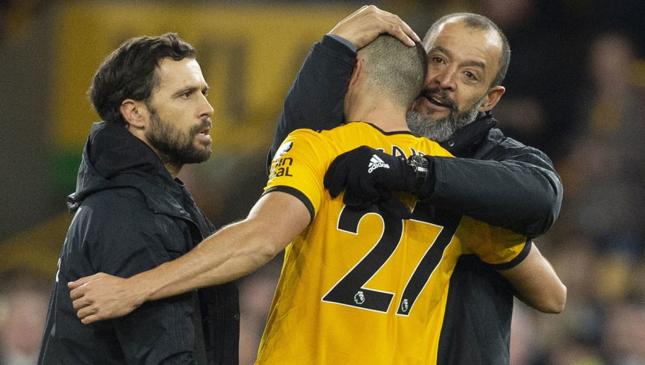 WOLVERHAMPTON, ENGLAND - DECEMBER 05: Wolverhampton Wanderers Manager Nuno Espirito Santo hugs Romain Saïss after victory in the Premier League match between Wolverhampton Wanderers and Chelsea FC at Molineux on December 5, 2018 in Wolverhampton, United Kingdom. (Photo by Visionhaus/Getty Images)