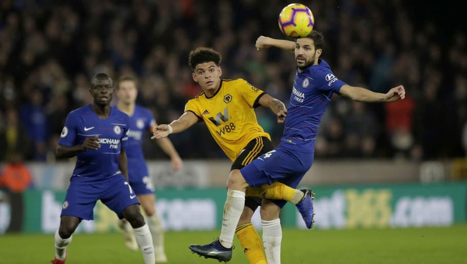 WOLVERHAMPTON, ENGLAND - DECEMBER 05: Morgan Gibbs-White of Wolverhampton Wanderers competes with Cesc Fabregas of Chelsea during the Premier League match between Wolverhampton Wanderers and Chelsea FC at Molineux on December 05, 2018 in Wolverhampton, United Kingdom. (Photo by Malcolm Couzens/Getty Images)