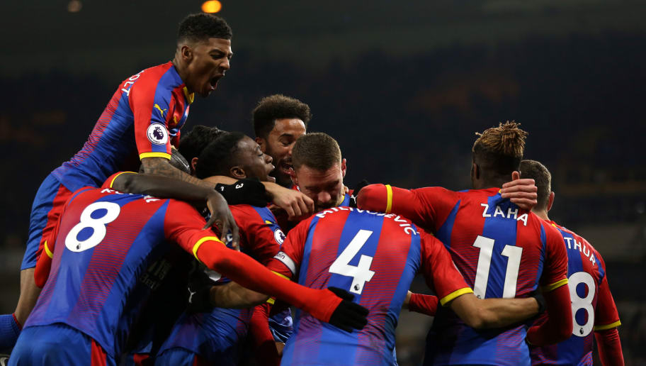 WOLVERHAMPTON, ENGLAND - JANUARY 02: Luka Milivojevic of Crystal Palace celebrates with his team mates after scoring a goal to make it 0-2 during the Premier League match between Wolverhampton Wanderers and Crystal Palace at Molineux on January 2, 2019 in Wolverhampton, United Kingdom. (Photo by Molly Darlington - AMA/Getty Images)