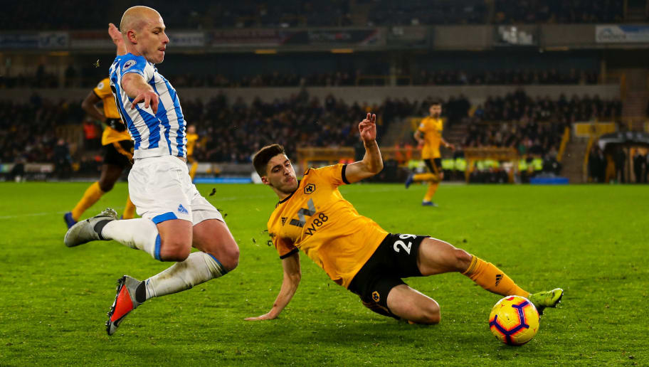 WOLVERHAMPTON, ENGLAND - NOVEMBER 25: Aaron Mooy of Huddersfield Town and Ruben Vinagre of Wolverhampton Wanderers during the Premier League match between Wolverhampton Wanderers and Huddersfield Town at Molineux on November 25, 2018 in Wolverhampton, United Kingdom. (Photo by Robbie Jay Barratt - AMA/Getty Images)