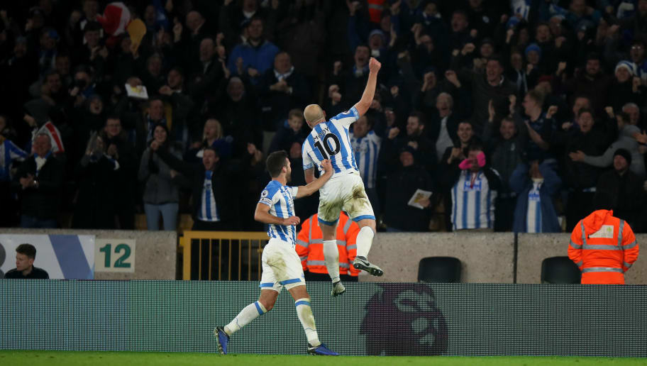 WOLVERHAMPTON, ENGLAND - NOVEMBER 25:  Aaron Mooy of Huddersfield Town celebrates after scoring a goal to make it 2-0 during the Premier League match between Wolverhampton Wanderers and Huddersfield Town at Molineux on November 25, 2018 in Wolverhampton, United Kingdom. (Photo by Molly Darlington - AMA/Getty Images)