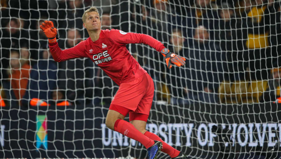 WOLVERHAMPTON, ENGLAND - NOVEMBER 25: Jonas Lossl of Huddersfield Town during the Premier League match between Wolverhampton Wanderers and Huddersfield Town at Molineux on November 25, 2018 in Wolverhampton, United Kingdom. (Photo by Matthew Ashton - AMA/Getty Images)