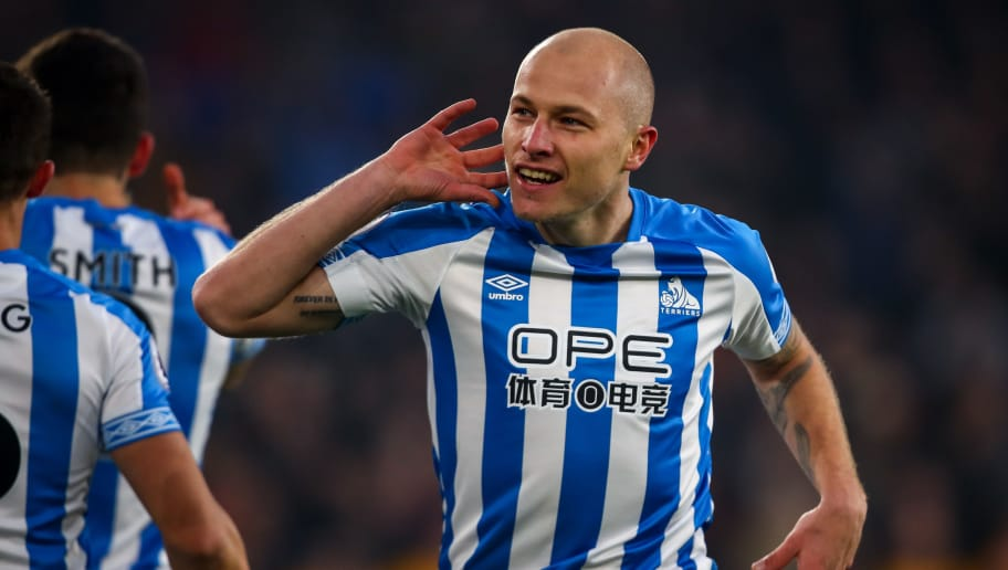 WOLVERHAMPTON, ENGLAND - NOVEMBER 25: Aaron Mooy of Huddersfield Town celebrates after scoring a goal to make it 0-1during the Premier League match between Wolverhampton Wanderers and Huddersfield Town at Molineux on November 25, 2018 in Wolverhampton, United Kingdom. (Photo by Robbie Jay Barratt - AMA/Getty Images)