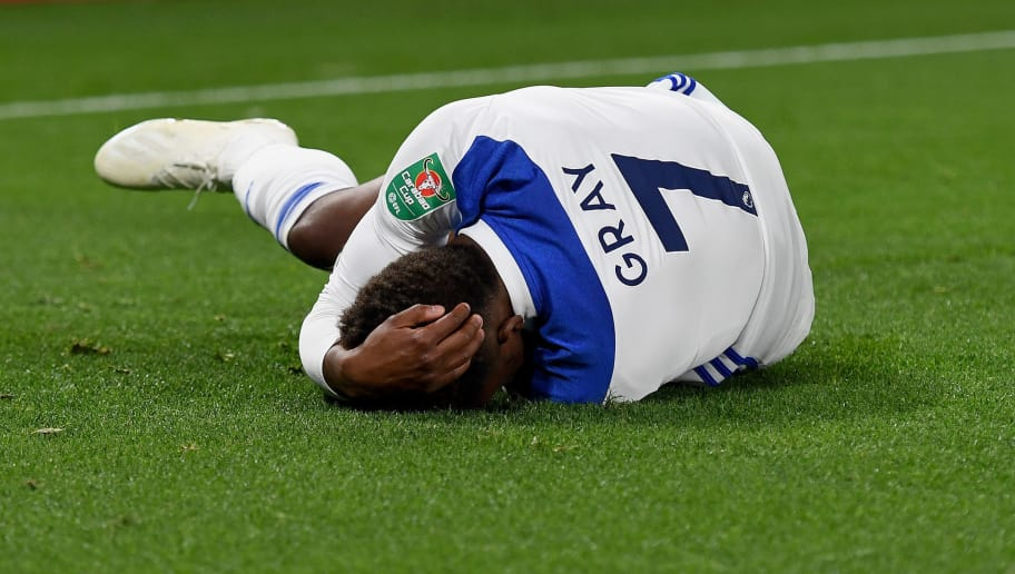 WOLVERHAMPTON, ENGLAND - SEPTEMBER 25: Demarai Gray of Leicester City reacts after he suffered an ankle injury during the Carabao Cup Third Round match between Wolverhampton Wanderers and Leicester City at Molineux on September 25, 2018 in Wolverhampton, England. (Photo by Sam Bagnall - AMA/Getty Images)