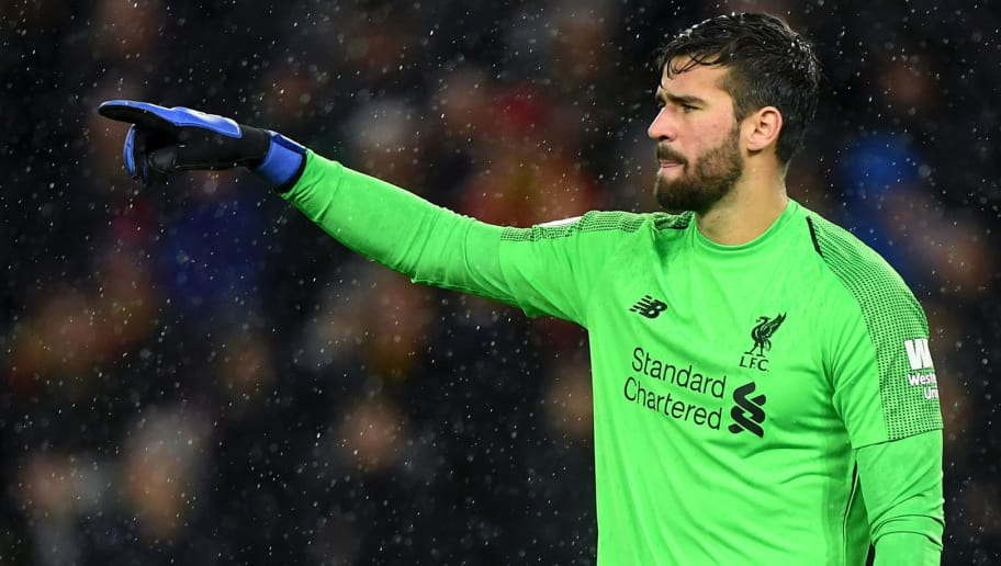 WOLVERHAMPTON, ENGLAND - DECEMBER 21: Alisson Becker of Liverpool during the Premier League match between Wolverhampton Wanderers and Liverpool FC at Molineux on December 21, 2018 in Wolverhampton, United Kingdom. (Photo by Sam Bagnall - AMA/Getty Images)