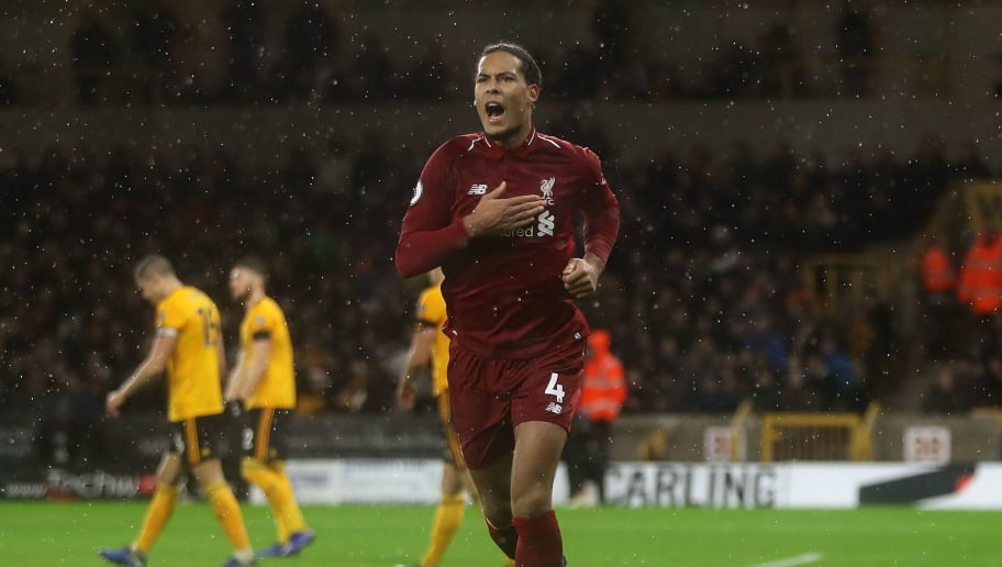 WOLVERHAMPTON, ENGLAND - DECEMBER 21:  Virgil van Dijk of Liverpool celebrates after scoring his team's second goal of the game during the Premier League match between Wolverhampton Wanderers and Liverpool FC at Molineux on December 21, 2018 in Wolverhampton, United Kingdom.  (Photo by David Rogers/Getty Images)