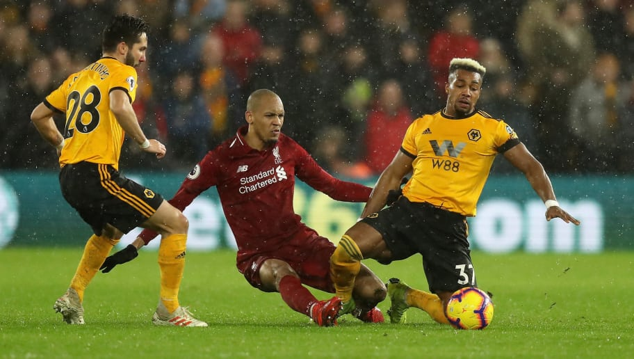 WOLVERHAMPTON, ENGLAND - DECEMBER 21:  Adama Traore of Wolverhampton Wanderers is tackled by Fabinho during the Premier League match between Wolverhampton Wanderers and Liverpool FC at Molineux on December 21, 2018 in Wolverhampton, United Kingdom.  (Photo by David Rogers/Getty Images)