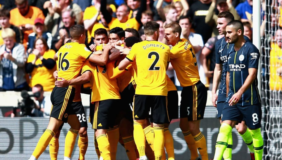 WOLVERHAMPTON, ENGLAND - AUGUST 25:  The Wolverhampton Wanderers team celebrate after their first goal during the Premier League match between Wolverhampton Wanderers and Manchester City at Molineux on August 25, 2018 in Wolverhampton, United Kingdom.  (Photo by Chris Brunskill/Fantasista/Getty Images)