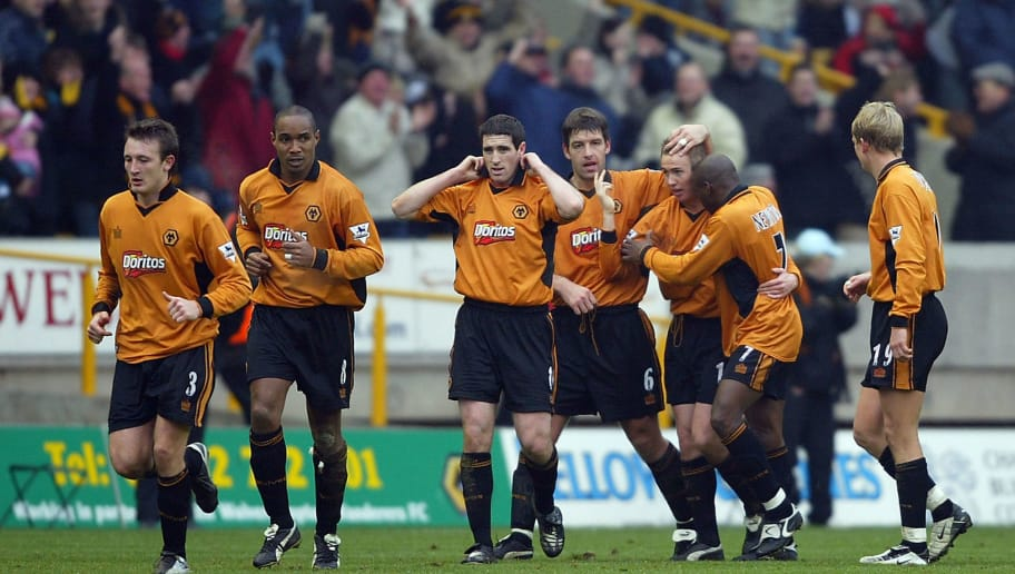 WOLVERHAMPTON, ENGLAND - JANUARY 17:  Kenny Miller (3rd R) of Wolverhampton Wanderers celebrates with his team-mates after scoring the first goal for Wolverhampton Wanderers during the FA Barclaycard Premiership match between Wolverhampton Wanderers and Manchester United at Molineux Stadium on January 17, 2004 in Wolverhampton, England.  (Photo by Shaun Botterill/Getty Images)