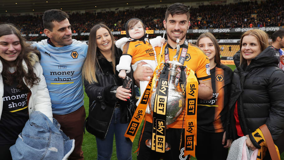 WOLVERHAMPTON, ENGLAND - APRIL 28:  Ruben Neves of Wolverhampton Wanderers poses with the Sky Bet Championship trophy after the Sky Bet Championship match between Wolverhampton Wanderers and Sheffield Wednesday at Molineux on April 28, 2018 in Wolverhampton, England.  (Photo by Richard Heathcote/Getty Images)