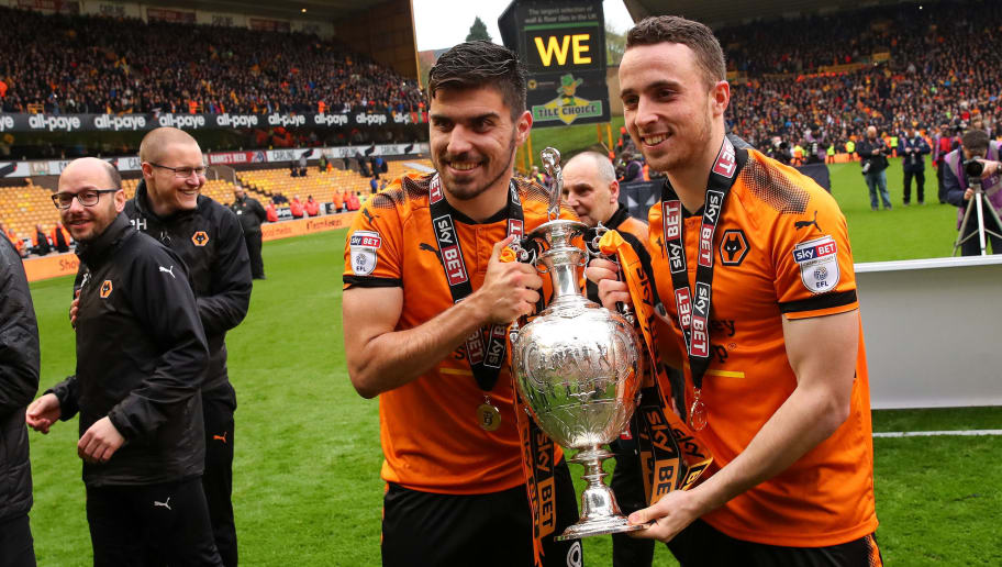 WOLVERHAMPTON, ENGLAND - APRIL 28: Ruben Neves of Wolverhampton Wanderers and Diogo Jota of Wolverhampton Wanderers celebrate with the Sky Bet Championship trophy  during the Sky Bet Championship match between Wolverhampton Wanderers and Sheffield Wednesday at Molineux on April 28, 2018 in Wolverhampton, England. (Photo by Robbie Jay Barratt - AMA/Getty Images)