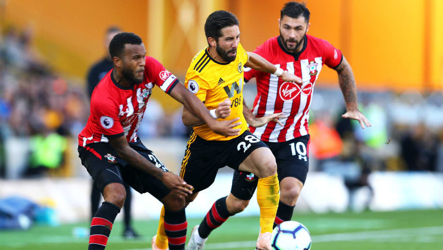 WOLVERHAMPTON, ENGLAND - SEPTEMBER 29:  Joao Moutinho of Wolverhampton Wanderers is challenged by Ryan Bertrand (L) of Southampton and Charlie Austin (R) of Southampton during the Premier League match between Wolverhampton Wanderers and Southampton FC at Molineux on September 29, 2018 in Wolverhampton, United Kingdom.  (Photo by Matthew Lewis/Getty Images)