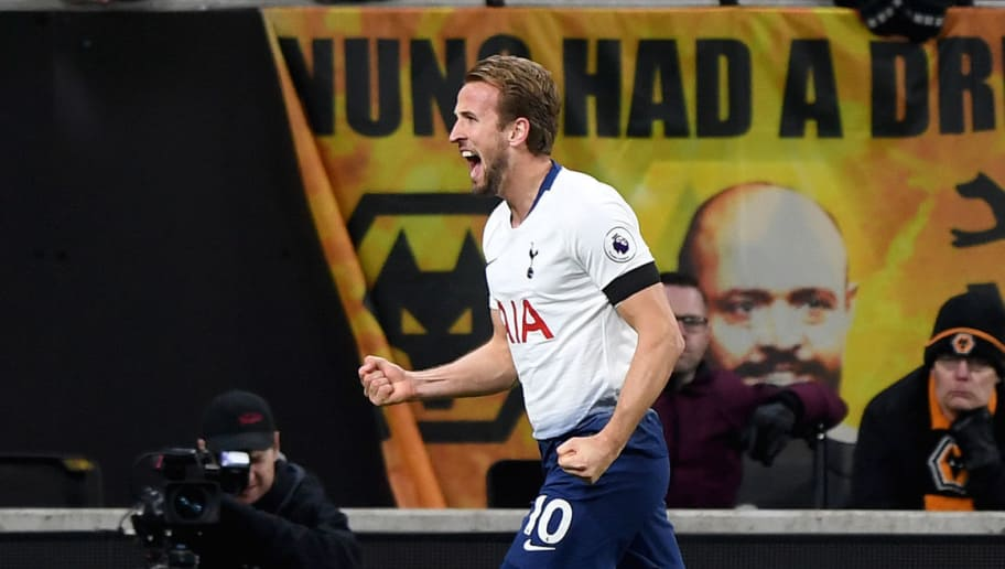 WOLVERHAMPTON, ENGLAND - NOVEMBER 03: Harry Kane of Tottenham Hotspur celebrates after scoring a goal to make it 0-3 during the Premier League match between Wolverhampton Wanderers and Tottenham Hotspur at Molineux on November 3, 2018 in Wolverhampton, United Kingdom. (Photo by Sam Bagnall - AMA/Getty Images)