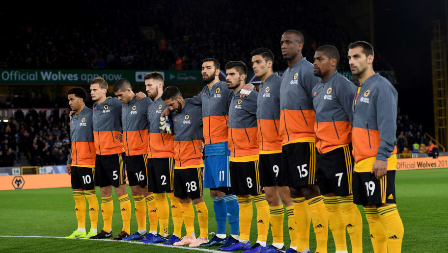WOLVERHAMPTON, ENGLAND - NOVEMBER 03: Players of Wolverhampton Wanderers stand in honour of remembrance day before the Premier League match between Wolverhampton Wanderers and Tottenham Hotspur at Molineux on November 3, 2018 in Wolverhampton, United Kingdom. (Photo by Sam Bagnall - AMA/Getty Images)