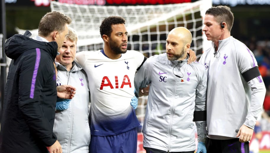 WOLVERHAMPTON, ENGLAND - NOVEMBER 03:  Mousa Dembele of Tottenham Hotspur is led off the pitch injured during the Premier League match between Wolverhampton Wanderers and Tottenham Hotspur at Molineux on November 3, 2018 in Wolverhampton, United Kingdom.  (Photo by Lynne Cameron/Getty Images)