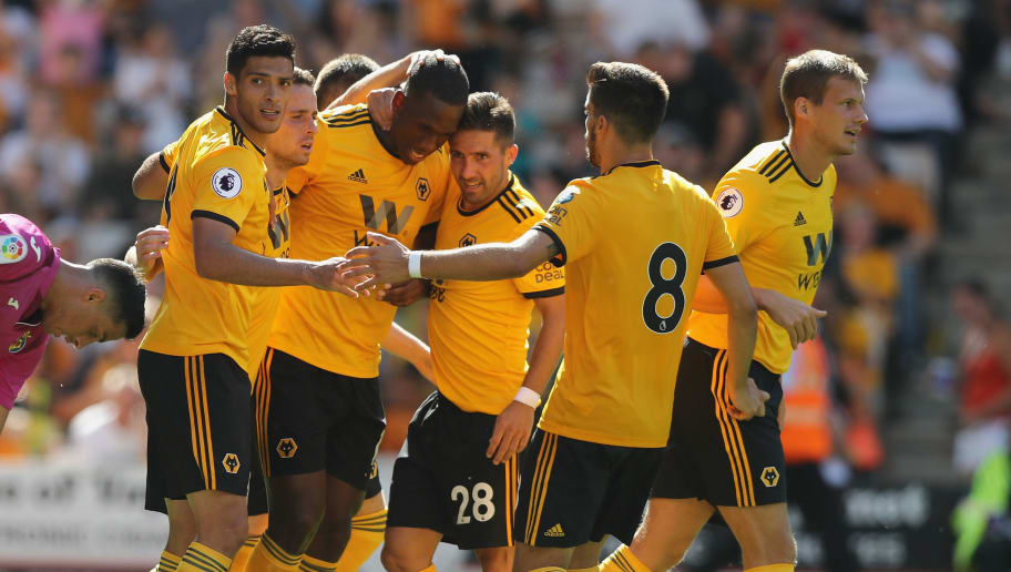 WOLVERHAMPTON, ENGLAND - AUGUST 04:  Willy Boly (R) of Wolverhamton Wanderers celebrates with team mates after scoring their first goal during the pre-season friendly match between Wolverhampton Wanderers and Villareal at Molineux on August 4, 2018 in Wolverhampton, England.  (Photo by David Rogers/Getty Images)