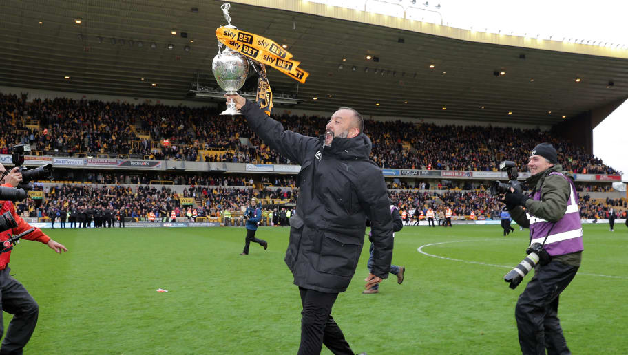 WOLVERHAMPTON, ENGLAND - APRIL 28:  Nuno Espirito Santo, Manager of Wolverhampton Wanderers celebrates with the Sky Bet Championship trophy following the Sky Bet Championship match between Wolverhampton Wanderers and Sheffield Wednesday at Molineux on April 28, 2018 in Wolverhampton, England.  (Photo by Richard Heathcote/Getty Images)