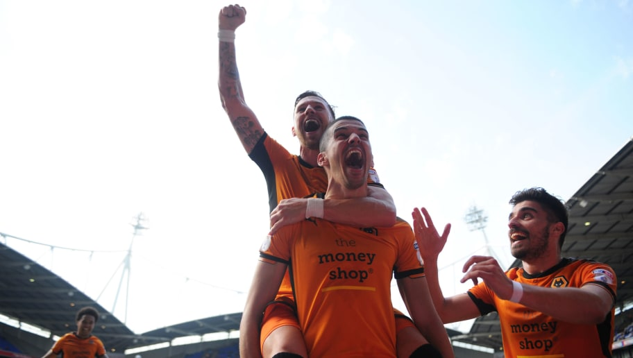 BOLTON, ENGLAND - APRIL 21: Conor Coady of Wolverhampton Wanderers celebrates after scoring a penalty during the Sky Bet Championship match between Bolton Wanderers and Wolverhampton Wanderers at Macron Stadium on April 21, 2018 in Bolton, England. (Photo by Nathan Stirk/Getty Images)