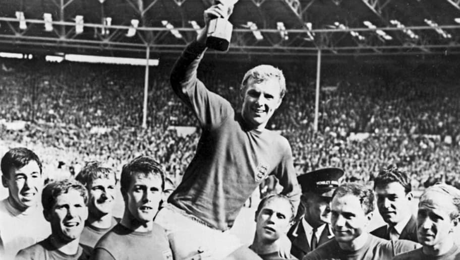 England's national soccer team captain Bobby Moore holds aloft the Jules Rimet trophy as he is carried by his teammates following England's victory over Germany (4-2 in extra time) in the World Cup final 30 July 1966 at Wembley stadium in London.(From L : Gordon Banks, Alan Ball, Roger Hunt, Geoff Hurst - who scored three goals - , Ray Wilson, George Cohen and Bobby Charlton) AFP PHOTO  / AFP / -        (Photo credit should read -/AFP/Getty Images)