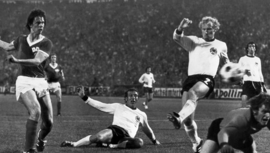 East German forward Juergen Sparwasser (L) scores the winning goal past West German defenders Horst Hoettges (C), Berti Vogts (2) and goalkeeper Sepp Maier 22 June 1974 in Hamburg during the World Cup first round soccer match between the two countries. East Germany beat West Germany 1-0. AFP PHOTO        (Photo credit should read STAFF/AFP/Getty Images)
