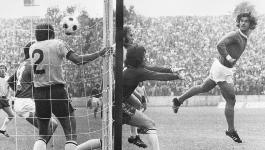 West German forward Gerd Mueller (R) scores on a header past Australian goalkeeper Jack Reilly and defender Doug Utjesenovic during the World Cup first round soccer match between West Germany and Australia 18 June 1974 in Hamburg. West Germany beat Australia 3-0.  AFP PHOTO  / AFP / STAFF        (Photo credit should read STAFF/AFP/Getty Images)