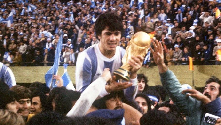 Argentine's national soccer team captain Daniel Passarella holds the World Cup trophy as he is carried on the shoulders of fans after Argentina defeated the Netherlands 3-1 in extra time, 25 June 1978 in Buenos Aires, during the World Cup soccer final. It is Argentina's first-ever World Cup title.   AFP PHOTO        (Photo credit should read STAFF/AFP/Getty Images)