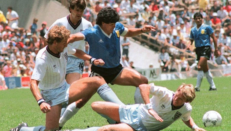Argentinian midfielder Diego Maradona (C) dribbles past three English defenders 22 June 1986 in Mexico City during the World Cup quarterfinal soccer match between Argentina and England. Maradona scored two goals, the first one with his left hand as he jumped for the ball in front of goalkeeper Peter Shilton, as Argentina beat England 2-1. AFP PHOTO (Photo by STAFF / AFP)        (Photo credit should read STAFF/AFP/Getty Images)