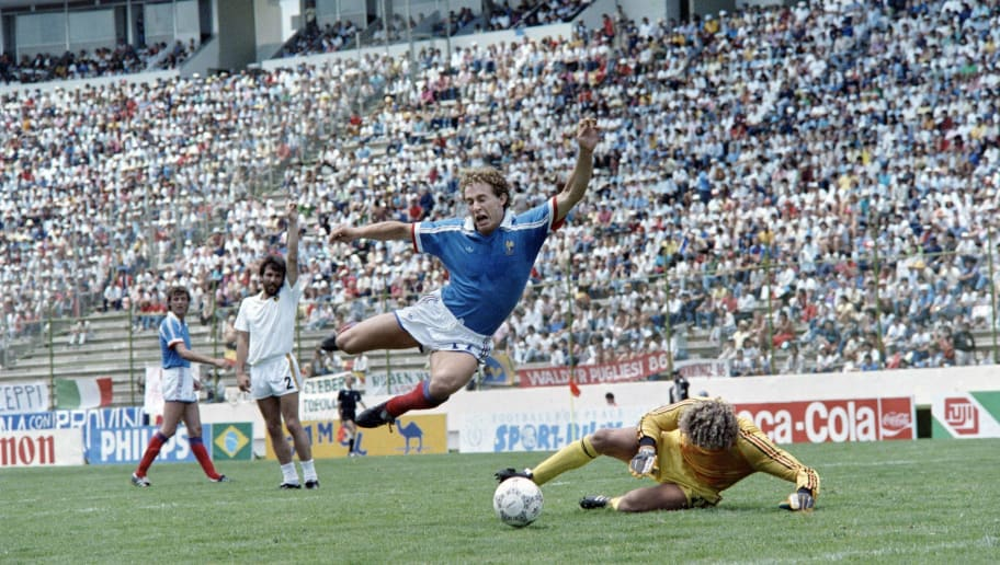 French football player Jean-Pierre Papin tries to score against his Belgian goalkeeper Jean-Marie Pfaff, during the World Cup football match between France and Belgium, on June 28, 1986 in Puebla.        (Photo credit should read STAFF/AFP/Getty Images)
