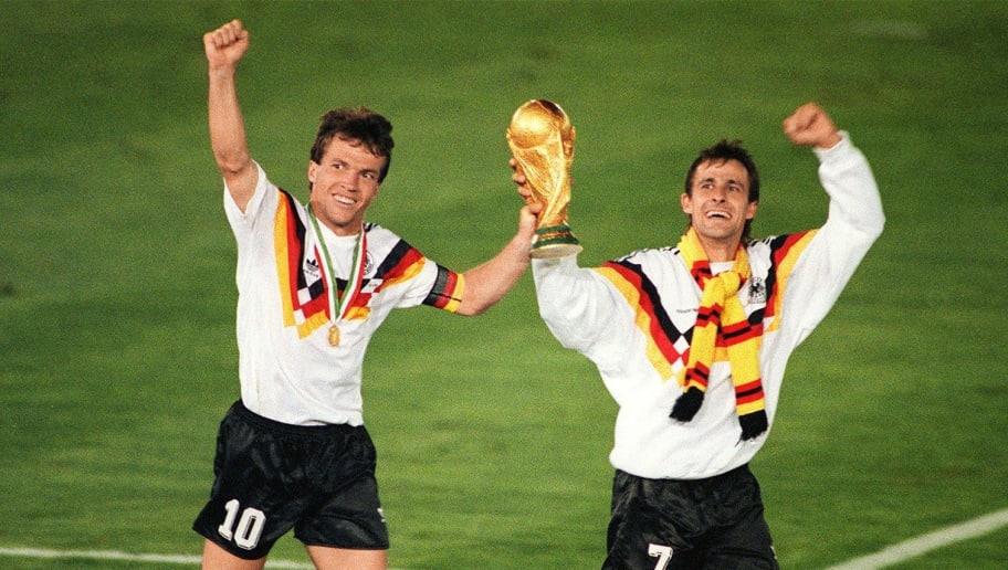 West German midfielder Lothar Matthaeus (L) and forward Pierre Littbarski celebrate with the World Cup trophy after their team beat the defending champions Argentina 1-0 on a penalty kick by defender Andreas Brehme in the World Cup final, 08 July 1990 in Rome. It is Germany's third World title (1954, 1974 and 1990). AFP PHOTO        (Photo credit should read STAFF/AFP/Getty Images)