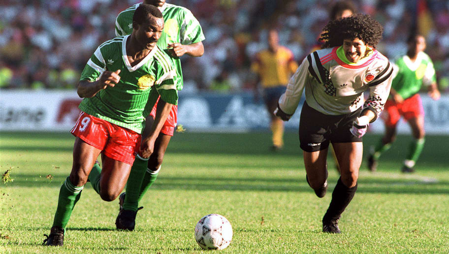 Forward Roger Milla from Cameroon runs past Colombian goalkeeper Jose Higuita (R) after stealing the ball from him on his way to score a goal 23 June 1990 in Naples during the World Cup second round soccer match between Cameroon and Colombia. Milla scored two goals in extra time to help Cameroon defeat Colombia 2-1 (0-0 at the end of regulation time). AFP PHOTO / AFP PHOTO / STAFF        (Photo credit should read STAFF/AFP/Getty Images)