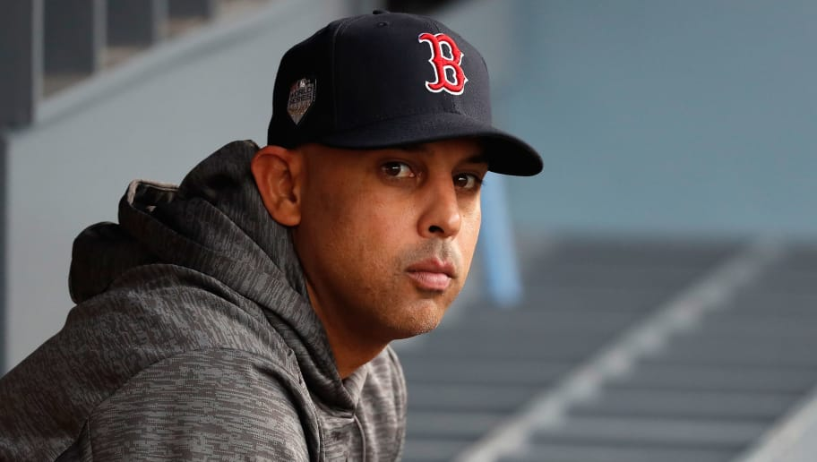 LOS ANGELES, CA - OCTOBER 28:  Alex Cora #20 of the Boston Red Sox sits in the dugout prior to Game Five of the 2018 World Series against the Los Angeles Dodgers at Dodger Stadium on October 28, 2018 in Los Angeles, California.  (Photo by Sean M. Haffey/Getty Images)