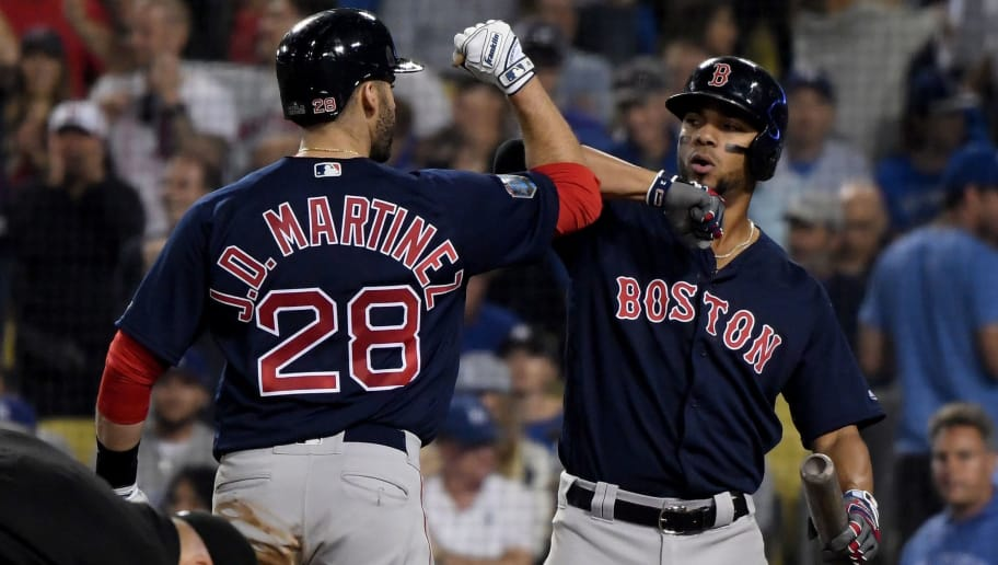 LOS ANGELES, CA - OCTOBER 28:  J.D. Martinez #28 of the Boston Red Sox is congratulated by his teammate Xander Bogaerts #2 after his seventh inning home run against the Los Angeles Dodgers in Game Five of the 2018 World Series at Dodger Stadium on October 28, 2018 in Los Angeles, California.  (Photo by Harry How/Getty Images)