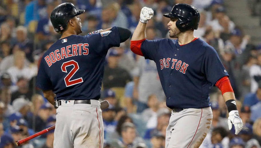 LOS ANGELES, CA - OCTOBER 28:  J.D. Martinez #28 of the Boston Red Sox is congratulated by his teammate Xander Bogaerts #2 after his seventh inning home run against the Los Angeles Dodgers in Game Five of the 2018 World Series at Dodger Stadium on October 28, 2018 in Los Angeles, California.  (Photo by Sean M. Haffey/Getty Images)
