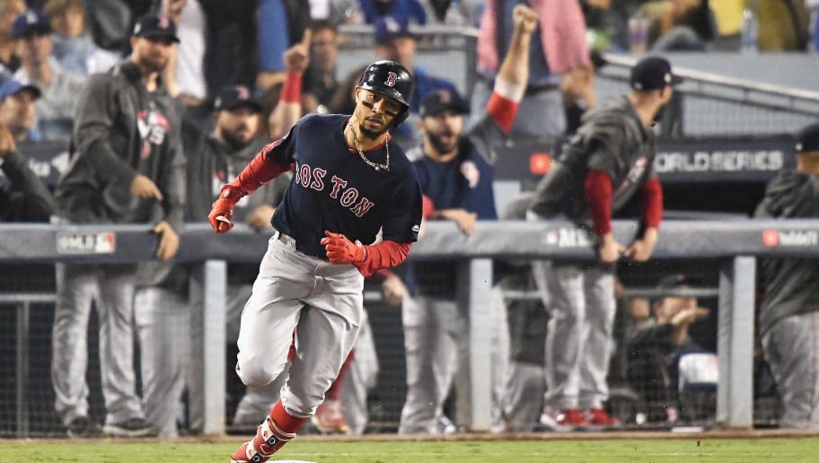 LOS ANGELES, CA - OCTOBER 28:  Mookie Betts #50 of the Boston Red Sox hits a sixth inning home run against the Los Angeles Dodgers in Game Five of the 2018 World Series at Dodger Stadium on October 28, 2018 in Los Angeles, California.  (Photo by Kevork Djansezian/Getty Images)