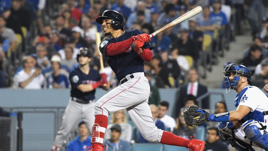 LOS ANGELES, CA - OCTOBER 28:  Mookie Betts #50 of the Boston Red Sox hits a sixth inning home run against the Los Angeles Dodgers in Game Five of the 2018 World Series at Dodger Stadium on October 28, 2018 in Los Angeles, California.  (Photo by Harry How/Getty Images)
