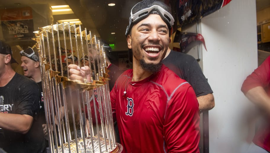 LOS ANGELES, CA - OCTOBER 28: Mookie Betts #50 of the Boston Red Sox celebrates with the World Series trophy after winning the 2018 World Series in game five of the 2018 World Series against the Los Angeles Dodgers on October 28, 2018 at Dodger Stadium in Los Angeles, California. (Photo by Billie Weiss/Boston Red Sox/Getty Images)
