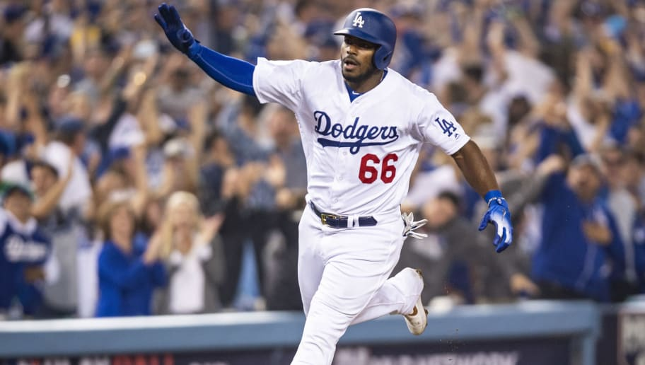 LOS ANGELES, CA - OCTOBER 27: Yasiel Puig #66 of the Los Angeles Dodgers reacts after hitting a three run home run during the sixth inning of game four of the 2018 World Series against the Boston Red Sox on October 27, 2018 at Dodger Stadium in Los Angeles, California. (Photo by Billie Weiss/Boston Red Sox/Getty Images)