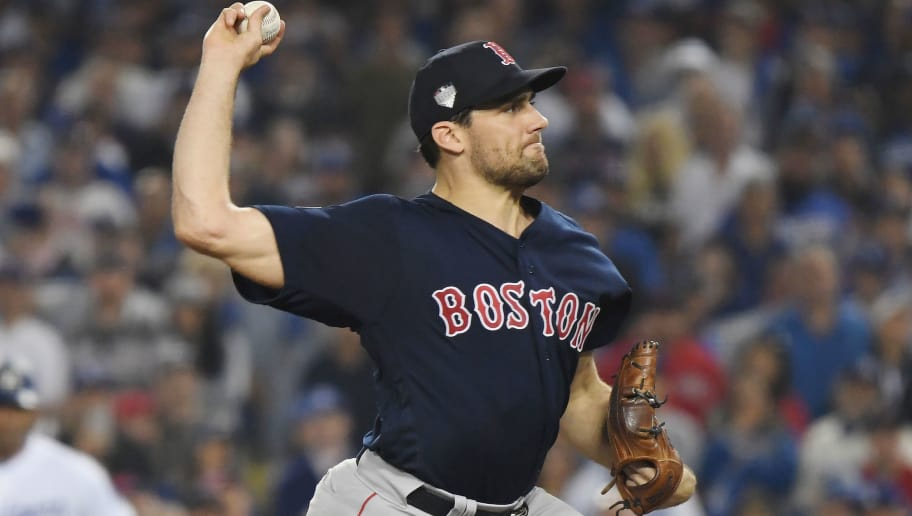 LOS ANGELES, CA - OCTOBER 26:  Nathan Eovaldi #17 of the Boston Red Sox delivers the pitch during the twelfth inning against the Los Angeles Dodgers in Game Three of the 2018 World Series at Dodger Stadium on October 26, 2018 in Los Angeles, California.  (Photo by Harry How/Getty Images)
