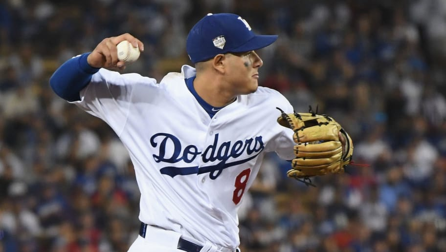 LOS ANGELES, CA - OCTOBER 26:  Manny Machado #8 of the Los Angeles Dodgers fields the ball during the eleventh inning against the Boston Red Sox in Game Three of the 2018 World Series at Dodger Stadium on October 26, 2018 in Los Angeles, California.  (Photo by Harry How/Getty Images)