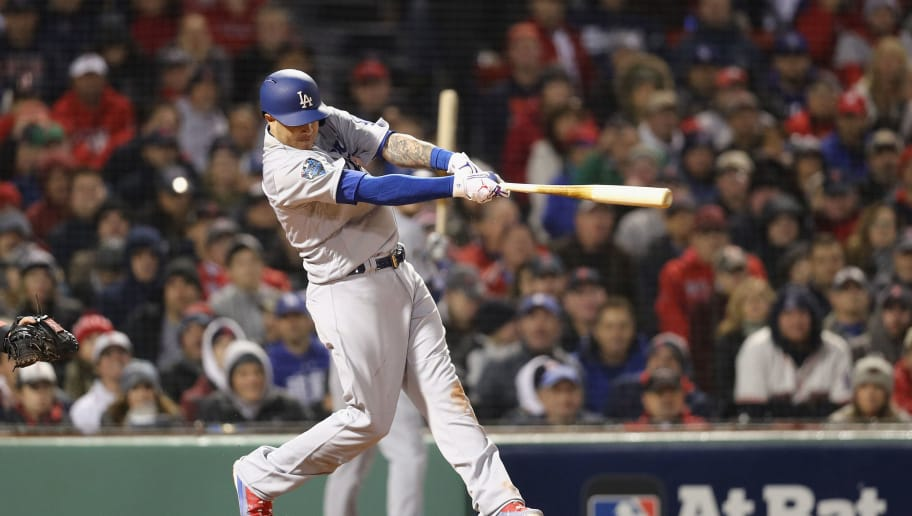 BOSTON, MA - OCTOBER 23:  Manny Machado #8 of the Los Angeles Dodgers hits an RBI sac-fly during the seventh inning against the Boston Red Sox in Game One of the 2018 World Series at Fenway Park on October 23, 2018 in Boston, Massachusetts.  (Photo by Maddie Meyer/Getty Images)