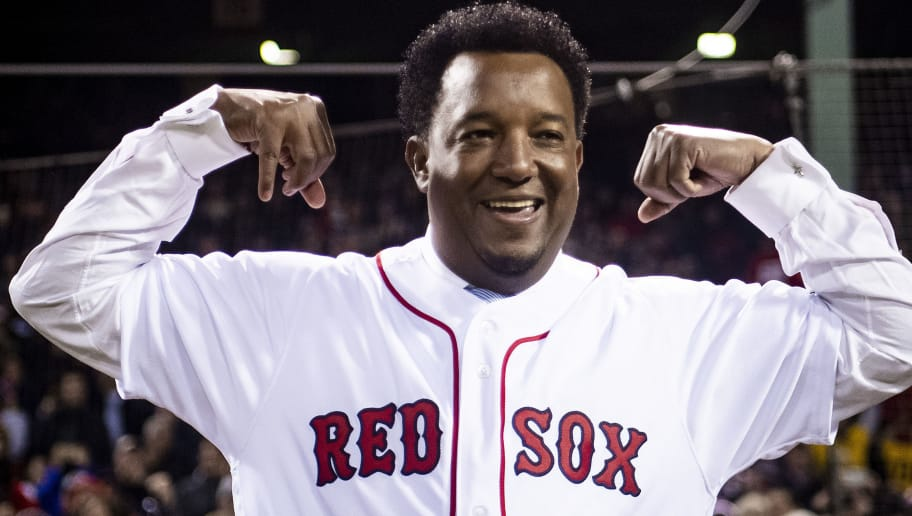 BOSTON, MA - OCTOBER 24: Former pitcher Pedro Martinez of the Boston Red Sox reacts as he is introduced before throwing out a ceremonial first pitch before game two of the 2018 World Series against the Los Angeles Dodgers on October 23, 2018 at Fenway Park in Boston, Massachusetts. (Photo by Billie Weiss/Boston Red Sox/Getty Images)