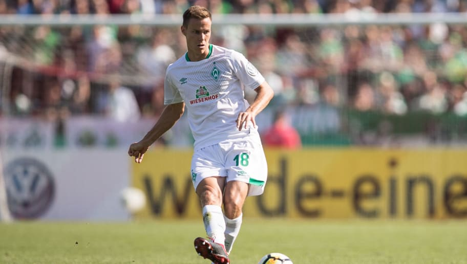 WORMS, GERMANY - AUGUST 18: Niklas Moisander #18 of Werder Bremen controls the ball during Wormatia Worms and Werder Bremen DFB Cup first round match on August 18, 2018 in Worms, Germany. (Photo by Maja Hitij/Bongarts/Getty Images)